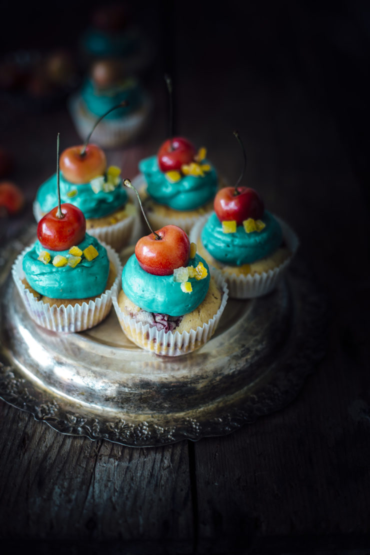 orange cupcakes with cherries